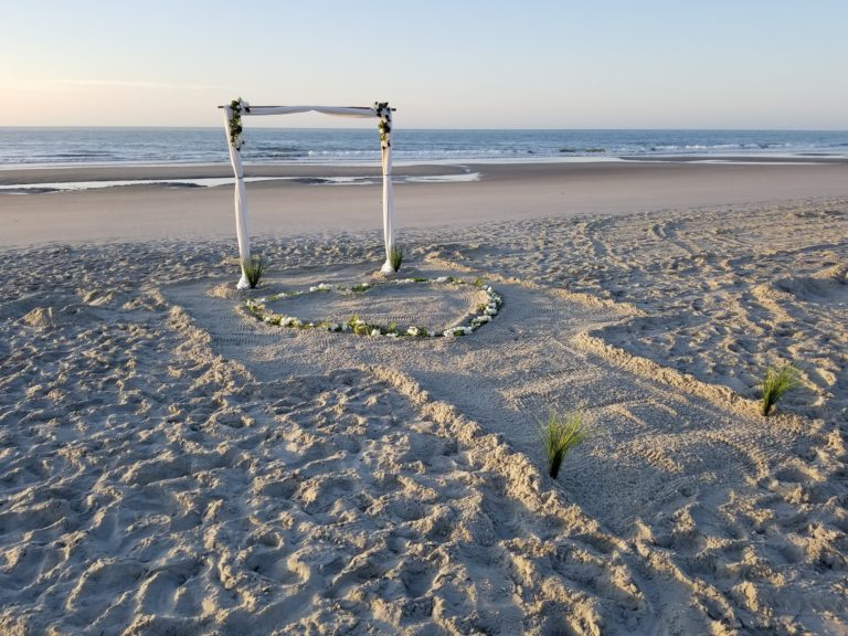 Wedding-Set-Up-Arch-Heart-in-Sand-768x576